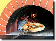 Wood-fired pizza topped with fresh mozzarella