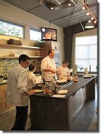 Chef Charlie Palmer and his sons leading a demonstration